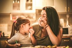 Mommy make me laughing. Little girl spending time with mother. Close up image Royalty Free Stock Photo