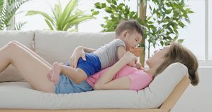 Mommy play with son. On sofa at home Royalty Free Stock Photography