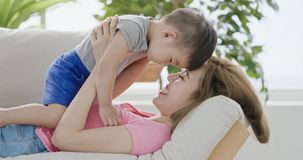 Mommy play with son. On sofa at home Stock Photo
