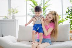 Mommy play with son. On sofa at home royalty free stock photo