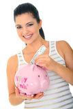 Mommy Saving Money. Save money concept. a woman holding pink piggybank and inserting money inside. isolated stock image