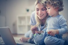 Mommy show me something interesting on laptop. Little boy. Childhood Royalty Free Stock Photography