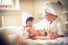Mommy tickling me . That make me laugh. Lifestyle Stock Photo