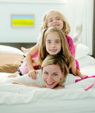 Mommy With Two Daughters Royalty Free Stock Images