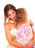 Mommys are the best. A picture of a young mother comforting her daughter over white background royalty free stock images