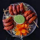 Momo цыпленка Tandoori представленное как еда ручки стоковое фото
