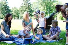 Moms and children at park. Mom's at park with their children Royalty Free Stock Image