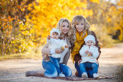 Moms and kids for a walk in the park in autumn Royalty Free Stock Photos