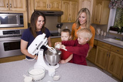 Moms and sons baking Stock Photo