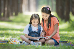Mon and baby take a home work Stock Image