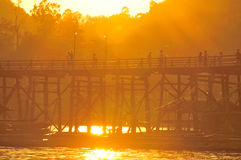 Mon Bridge and sunset, old construct in Thailand Royalty Free Stock Photos
