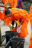 Mon buddhist monks collecting alms Stock Images