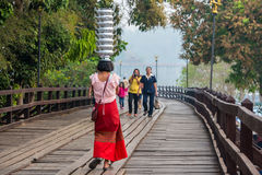 Mon girl is walking for showoff to tourists. Royalty Free Stock Photography