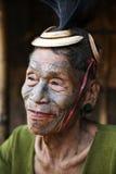 Mon Headhunter. Singha Chingnyu, Nagaland/India - December 8, 2013: Elderly Tattooed faced former Mon Headhunter from Singha Chingnyu. Naga tribes practised royalty free stock photography