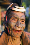 Mon Headhunter. Singha Chingnyu, Nagaland/India - December 8, 2013: Elderly Tattooed faced former Mon Headhunter from Singha Chingnyu. Naga tribes practised stock image