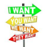 Mon veut et a besoin contre le vôtre - des désirs égoïstes sur des signes Photos stock