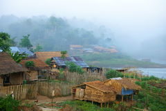 Mon village, bathing in fog. Bathing in the dawn's fog, Wangka, mon minority village inhabited by mon refugees from burma, on khao laem reservoir artificial stock photography