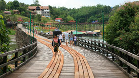 Mon woman carrying basket on head at wooden bridge Stock Photo