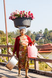 Mon woman carrying flower on head Stock Images