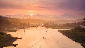 Mon wood Bridge and sunrise Stock Image