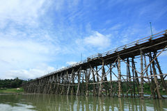 Mon wooden bridge against blue sky at Sangklaburi Stock Photo