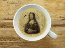 Mona lisa in coffee froth Royalty Free Stock Image