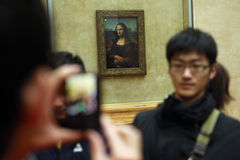 Mona Lisa by Leonardo da Vinci in the Louvre Museum. Stock Photos