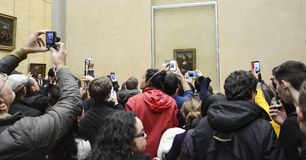 Mona Lisa, Louvre. Taking pictures of Mona Lisa at Louvre, Paris, France Royalty Free Stock Image