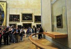 Mona  Lisa at Musée de Loure Paris. Tourists look at a well-protected Mona Lisa (by Leonardo da Vinci) at the Musée du Louvre, Paris, France Stock Images