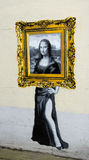 Mona lisa out of frame catman painting Royalty Free Stock Image