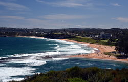Mona Vale beach and rock pool in a distant panoramic view Stock Photo