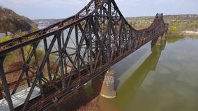 Rising Aerial View of Train on Bridge in Western Pennsylvania. 8422 MONACA, PA - Circa April, 2017 - A daytime rising aerial view of a cargo train traveling on a stock footage