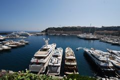 Monaco Bay, marina, harbor, dock, body of water. Monaco Bay is marina, body of water and boat. That marvel has harbor, sea and coast and that beauty contains stock images