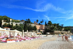 Beach. People reclining on a beautiful beach in Monaco on a sunny day Royalty Free Stock Photo