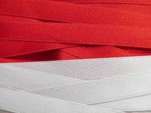 Monaco flag or banner. Made with red and white ribbons Royalty Free Stock Images