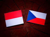 Monaco flag with Czech flag on a tree stump  Royalty Free Stock Image