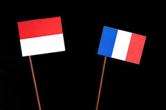 Monaco flag with French flag  on black Royalty Free Stock Photo