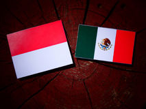 Monaco flag with Mexican flag on a tree stump isolated Stock Photography