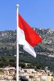 Monaco flag at Monaco. Monaco flag behind a Panoramic View of Monte Carlo, Monaco Stock Image