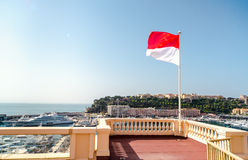 Monaco flag. National flag of of the Principality of Monaco and view of port Royalty Free Stock Photography
