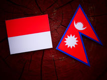 Monaco flag with Nepali flag on a tree stump isolated Stock Photography