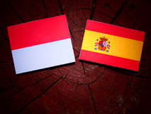 Monaco flag with Spanish flag on a tree stump  Stock Images