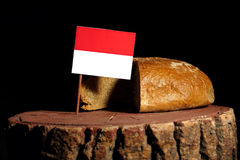 Monaco flag on a stump with bread Royalty Free Stock Photography
