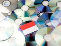 Monaco flag on top of CD and DVD pile  on white Stock Photography