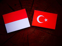 Monaco flag with Turkish flag on a tree stump  Royalty Free Stock Image
