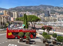 Monaco, France – July 24, 2017: Red double-decker bus tour driving on city streets of luxury  Monaco (Monte Carlo). Monaco, France – July 24, 2017: Red Royalty Free Stock Image