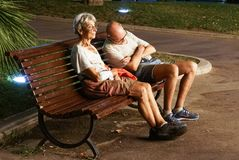 Monaco France 16 August 2017 : Man is sleeping on a park bench in the city . Homeless couple Royalty Free Stock Image