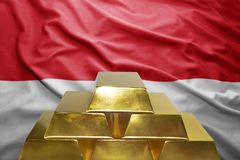 Monaco gold reserves. Shining golden bullions on the monaco flag background stock image