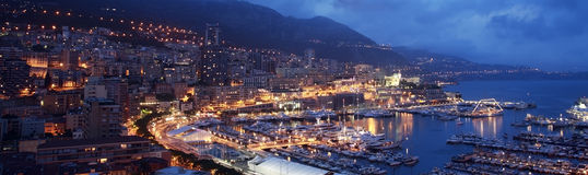 Monaco harbor night scene Stock Photos