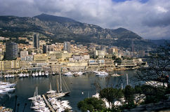 Monaco Harbour. Luxury yachts dock in Monaco, home of the Monaco Grand Prix and Monte Carlo Casino, visible in the background Royalty Free Stock Photo